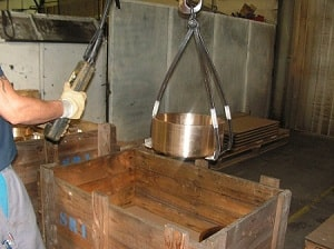 packing of an aluminium-bronze sand casting in a wooden crate for transportation